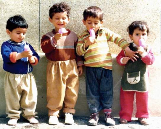 My cousins and I are eating homemade ice-cream. This photo was taken during the civil war between Iran-Iraq in Mahabad (eastern Kurdistan/Iran).